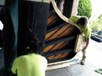 2 Piano Removalists Moving a Grand Piano